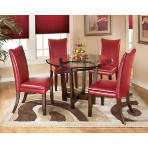 Ashley Charrell 5pc Round Glass Top Table Dining Set w Red Chairs