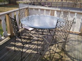 Vintage Wrought Iron Really Heavy Glass Top Table and Four Chairs Set
