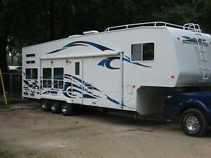 06 Toy Hauler 33' Fifth Wheel 14' Garage Plus