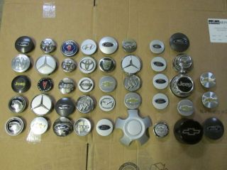 Lot of 43 Used Small Wheel Center Caps Saab Ford Nissan